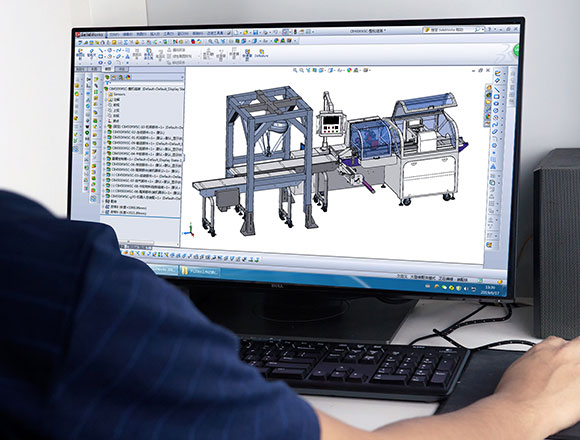 An engineer is designing the packaging machine with a software